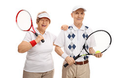 Elderly tennis players looking at the camera and smiling Stock Images