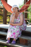 Elderly thoughtful Caucasian woman at summer veranda Royalty Free Stock Photo
