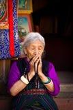Elderly Tibetan Buddhist lady of Boudhanath Temple, Kathmandu, Nepal Royalty Free Stock Image