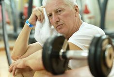 Elderly tired man. In a gym with towel Stock Photography
