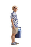 Elderly tourist with a cooling box waiting in line. Full length profile shot of an elderly tourist with a cooling box waiting in line isolated on white Stock Photo