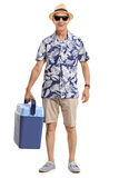 Elderly tourist holding a cooling box Stock Images