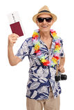 Elderly tourist holding a passport and a camera Stock Image