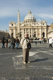Elderly tourist in Rome. A perfect elderly tourist with an expressively annoying smile in front of the Vatican, Rome, Saint-Peter Basilica stock photo