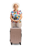 Elderly tourist with a suitcase Royalty Free Stock Image