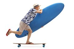Elderly tourist with a surfboard riding a longboard. Full length profile shot of an elderly tourist with a surfboard riding a longboard isolated on white royalty free stock photo