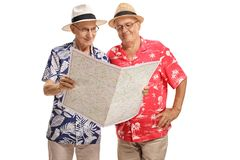 Elderly tourists looking at a map Stock Images