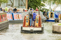 Elderly tourists Narrow Boating in Stoke On Tent. Stoke On Trent, England - June 5, 2011: Elderly man and woman on canal narrow boat at Stoke-on-Trent's royalty free stock image