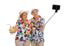 Elderly tourists taking a selfie with a stick. Isolated on white background Stock Photography