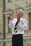 Elderly trumpeter laughs. Stock Image