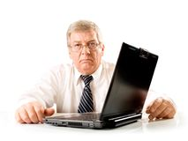 Elderly unhappy pensive man. Elderly solid unhappy pensive business man or teacher on laptop, isolated on white background Stock Image