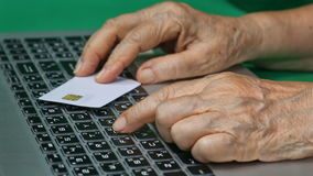 Elderly using credit card for online shopping. Elderly person using credit card for online shopping stock footage