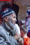 Elderly Uyghur man at Kashgar Sunday Bazaar, China. Kashgar, Xinjiang, China - September 16, 2018 : Elder Uyghur man at the Sunday Bazaar in Kashgar, or Kashi stock image