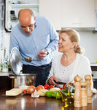 Elderly vegetarian family cooking food together Royalty Free Stock Photo