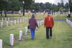 Elderly Veteran and Wife in Cemetery. Los Angeles, California stock photo