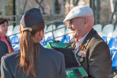 Elderly veteran of World War II with accordion. Tyumen, Russia - May 9. 2009: Victory Day in Tyumen. Elderly funny veteran of World War II with accordion goes on stock images