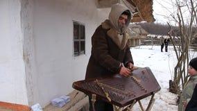 Elderly village musician stock footage