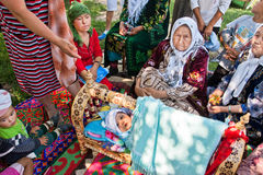 Elderly village women tell the story of folk traditions of childbirth in Kyrgyzstan stock photo