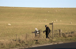 Elderly walkers walk in the English countryside Stock Photography