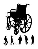 Elderly and Wheel Chair Silhouettes Royalty Free Stock Images