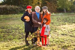 An elderly white woman with her daughter and granddaughters royalty free stock image