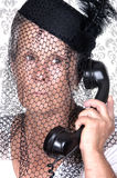 Elderly widow talking on old phone Royalty Free Stock Photos