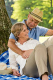 Elderly wife and husband hugging in park Royalty Free Stock Photos