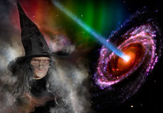 Elderly Witch With Black Hat Casting Spells,. Full Moon And Fiery Galaxy Background Royalty Free Stock Images