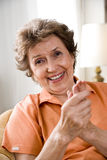 Elderly woman. Close-up of elderly woman rubbing her fingers Stock Image
