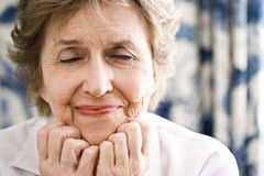 Elderly woman stock images