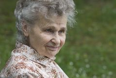Elderly woman. Portrait of the elderly woman outdoors Stock Photography