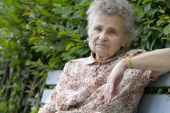 Elderly woman. Portrait of the elderly woman outdoors Royalty Free Stock Photo