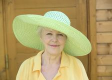 The elderly woman. In a hat smiles Stock Images