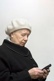 The elderly woman. With mobile phone Stock Photography