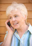 The elderly woman. Speaks by phone Stock Photos