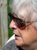 Elderly woman. Portrait happy smiling lovely elderly woman outside Royalty Free Stock Photo