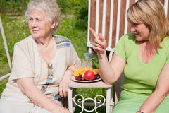 Elderly woman with adult daughter Stock Image