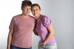 Elderly woman with adult daughter. Elderly women with adult daughter in studio stock images
