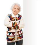 Elderly woman alongside of ad board Royalty Free Stock Photo