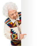 Elderly woman alongside of ad board Stock Photo