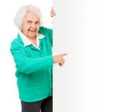 Elderly woman alongside of ad board Royalty Free Stock Image