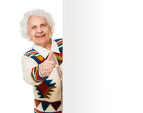 Elderly woman alongside of ad board Royalty Free Stock Images
