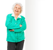 Elderly woman alongside of ad board. Over white background stock photo