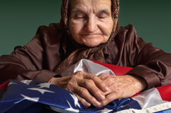 Elderly woman with American flag Royalty Free Stock Photography