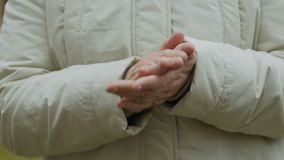 Elderly woman applauds. Grandmother claps hands. Focus on old woman`s hands with wrinkles. Slowmotion stock video