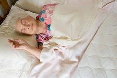 Elderly woman asleep in bed Stock Photos