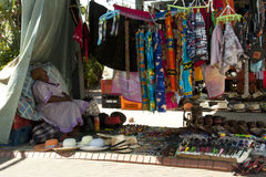 Elderly Woman Asleep in Colorful Sreet Vendor Stall Royalty Free Stock Photos