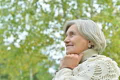 Elderly woman in autumn park Royalty Free Stock Photos