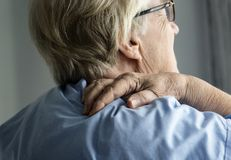 Elderly woman with back pain Stock Photography