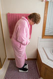 Elderly Woman Bathroom Weight Scale Stock Image